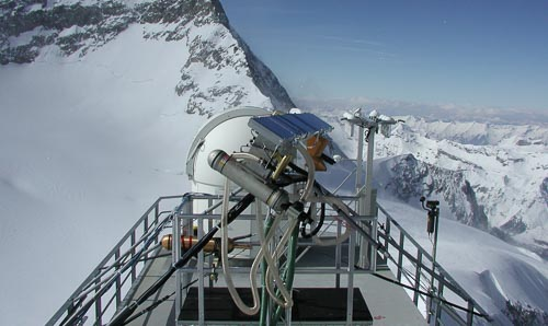 Environmental research station on top of a snowy mountain.