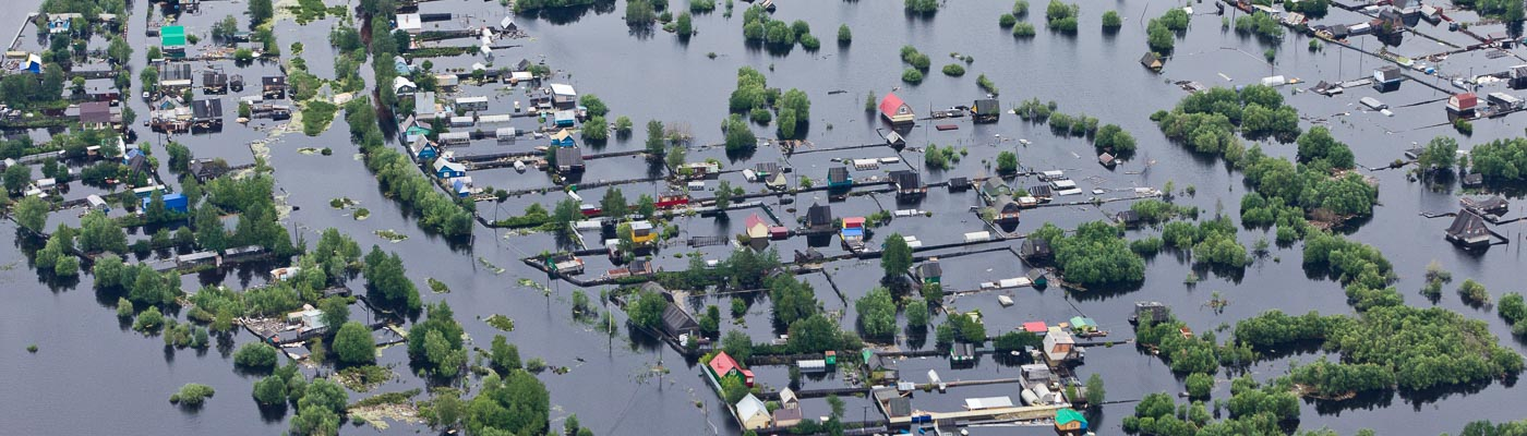 An aerial view of flooded houses.