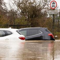 two cars submerged under flood water